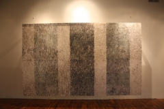 Image of installation at MAP Gallery in Easthampton. Large ink drawing hovers above floor. Many segments of patterned abstraction combine to form three darker vertical strips and 4 light strips