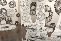 Large scale drawing installation at William Blizzard Gallery. Large muscle-tissue like donut forms challenge the scale of a room by completely filling the space, streaming down walls and covering the floor.