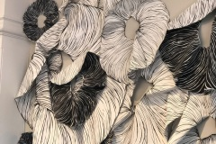 Large scale, site specific drawing installation. Large muscle-tissue like donut forms fold and flow over the walls.