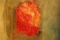 a digital photograph of an orange rock from the floor of the Death Valley landscape printed on linen and collaged into a green painted field on canvas