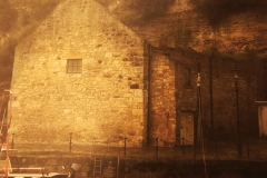 digital photograph of stone boathouse in a Scottish harbor