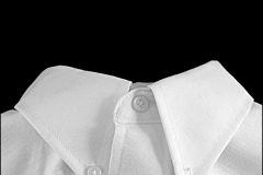 Black and white photograph of a white shirt collar