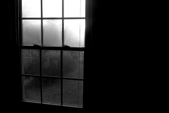 Black and white photograph of a window with shadows