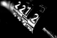 Black and white photograph close up of a bicycle lock