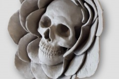 Sculpted skull form set within a flower form.