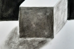 A cube with shading to show depth.