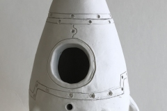 Jar in the shape of the rocket ship.