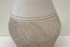 oval vase form with highly textured bottom.