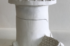 jar in the shape of a lighthouse.