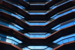 geometric photograph of the repeating pattern of balconies of a high rise building.