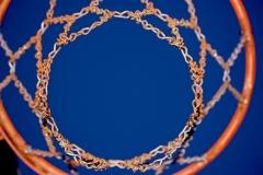 close up image of a basketball hoop from below.