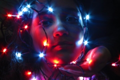 girl with lights around her face.