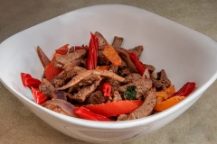 image of meat and onion sautee with twizzlers.