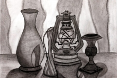 still life of various lanterns and vases on a table.