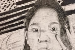 Self portrait of a woman with her hand up, two flags converge in the background behind her head.