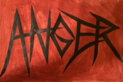 Anger in angular lettering on red background.