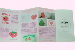 Accordian fold pages of Strawbby World inside pages.