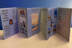 Accordian fold book depicting Quick Trips logo and brand for a travel company.