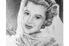 A study of values of a famous star of the 1940s. Ingrid is wrapped is a sheer scarf with the light shining through it.