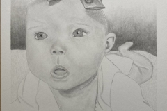 Graphite value drawing of an infant laying on her stomach with a look of wonder on her face.
