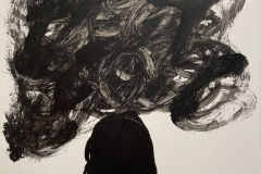 silhouette of a human head and shoulders, with a swirley cloud above the head.