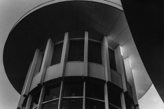 Grainy black and white photograph of the top of the tower of a building