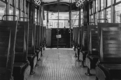 black and white photo of the inside of a bus or trolley.