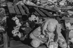 black and white photo of mickey mouse and other dolls