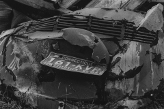 black and white photo of a decrepit piece of metal