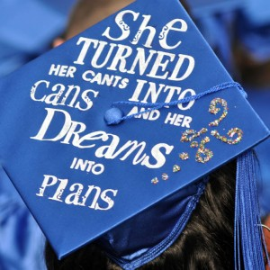 """Graduation cap with letters pasted on that make the phrase """"She turned her cants into cans and dreams into plans"""""""