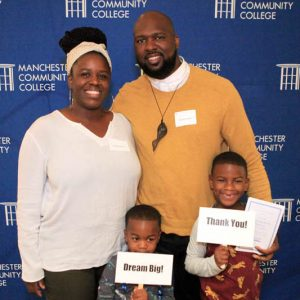 MCC scholarship recipients Greg and LaShawnda with their two children.