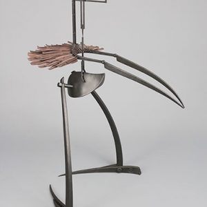 A metal statue generally shaped like a bird