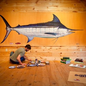 """(ALL INTERNAL RIGHTS, LIMITED EXTERNAL RIGHTS) April 2012. James Prosek working in his studio in Easton, CT. He sits in front of his large painting of a swordfish. James is working on his book and exhibition project, """"Ocean Fishes"""". Book will be published by Rizzoli and original paintings will be exhibited around the country. The entire project has been documented by filmmakers Hal Clifford and Jason Houston. Their short documentary, """"Picture The Leviathan"""" will premier at Mountainfilm in Telluride late May 2012. PHOTO BY ©2012 Jason Houston"""