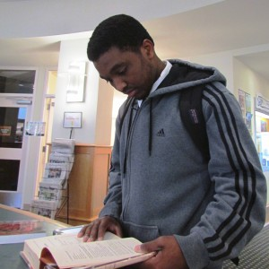 MCC student at the Library circulation desk