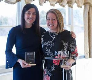 MCC professors Carla Adams and Alison Mackenzie standing with their service awards