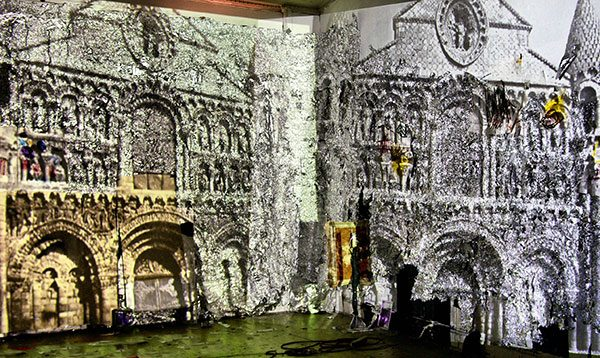 Piece of art depicting an ancient building - materials used are aluminum foil, canvas and paint